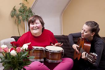 Two women making music
