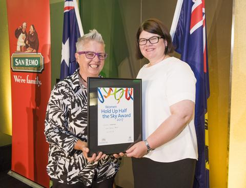 Sandra Dann receiving and award in 2017 from Minister Bettison