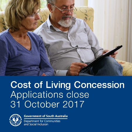 Man and woman reading brochure on applying for the cost of living concession payment