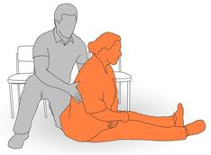 4. Place client's arm and opposite hand on to chair for support and assist to move into a kneeling position.