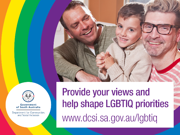Two male carers or parents with a young male child pictured as family
