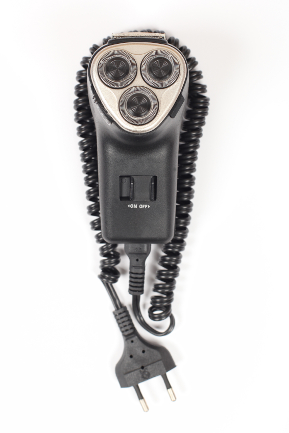 an electric razor with the cord coiled around it