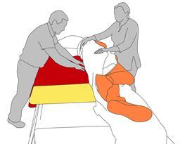 2. Put slide board into position with slide sheet.
